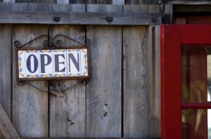 istock_small-bus-open-sign-red-door