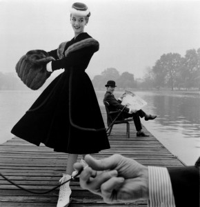 Skater wears a Digby Morton fur trimmed velvet coat, city gentleman Michael Bentley in the background, London. Daily Express, 1955	 John French © Victoria and Albert Museum, London