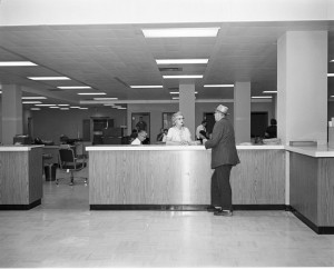 Customer_service_counter_in_Seattle_Municipal_Building,_1962