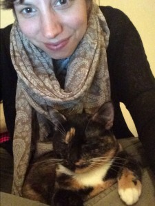Bridget Conway writes her daily poem whilst cuddling her cat