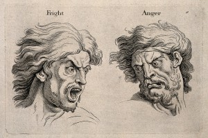 "Image via (a href=""https://commons.wikimedia.org/wiki/File:A_frightened_and_an_angry_face,_left_and_right_respectively._Wellcome_V0009326.jpg"">Wikimedia Commons"